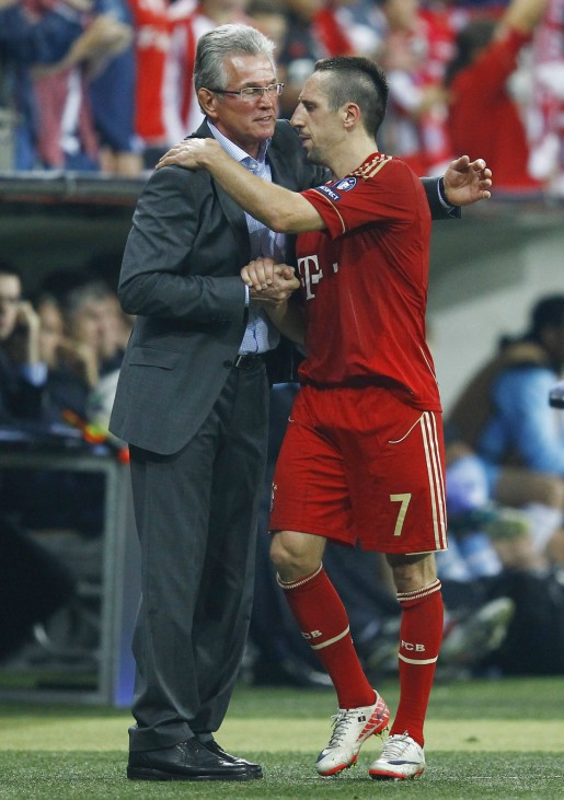 Coach of Bayern Munich Heynckes hugs Ribery after substitution during their Champions League Group A soccer match against Manchester City in Munich