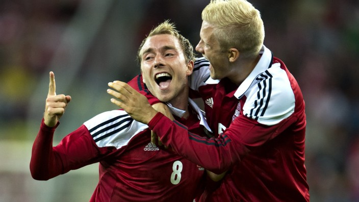Denmark's Eriksen celebrates after scoring his team's first goal against Poland with teammate Boilesen during their international friendly soccer match in Gdansk
