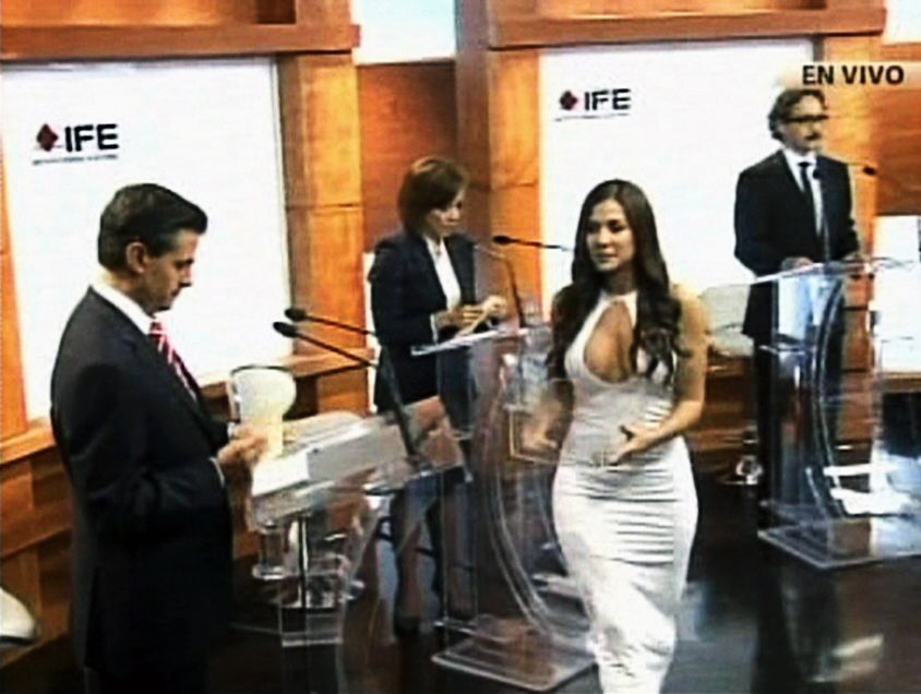 Handout still image taken from video shows former Playboy model and presidential debate assistant Orayen handing out cards to four candidates during a televised debate at the Federal Electoral Institute in Mexico City; Julia Orayen