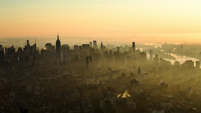 A view of fog over the New York skyline as seen from the One World Trade Center during sunrise in New York