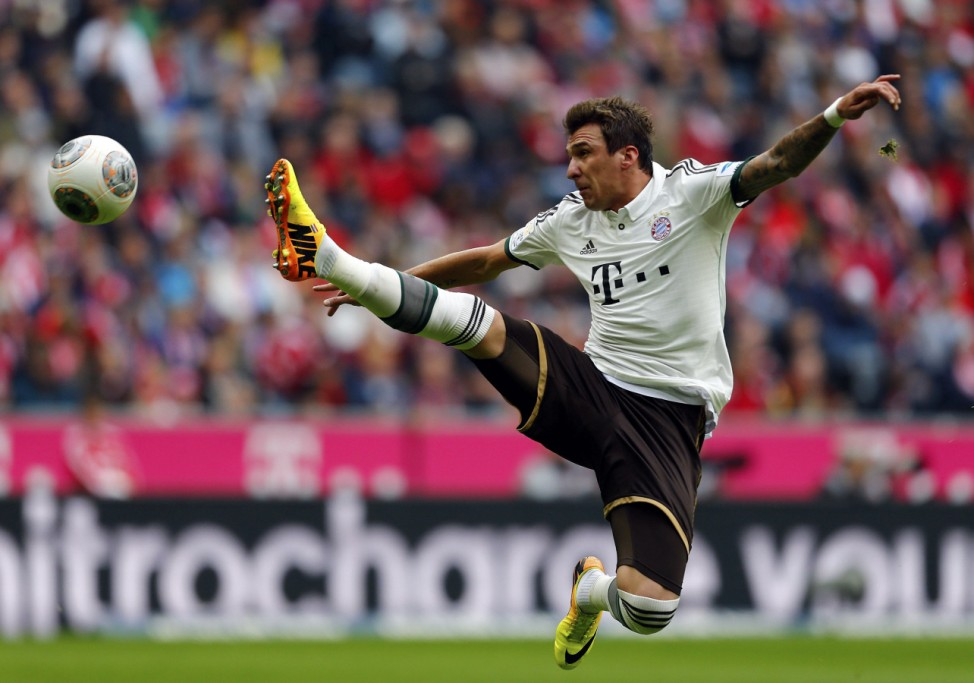 Mandzukic of FC Bayern Munich jumps for the ball during their German first division Bundesliga soccer match against Hanover 96 in Munich