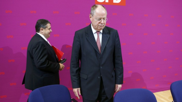 Social Democratic Party (SPD) top candidate Steinbrueck and party leader Gabriel arrive for the presidium meeting at the SPD headquarters in Berlin