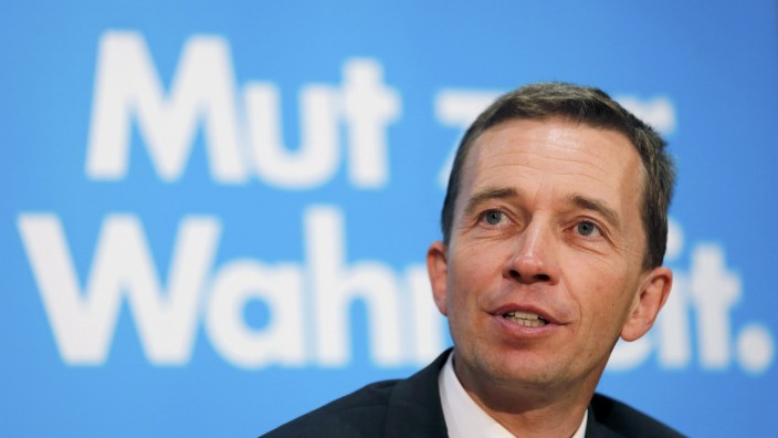 AfD party top candidate Lucke addresses the media and party members during a party board meeting in Berlin