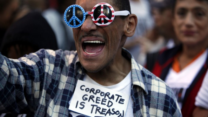 An Occupy Wall Street protester chants slogans along 47th Street in New York