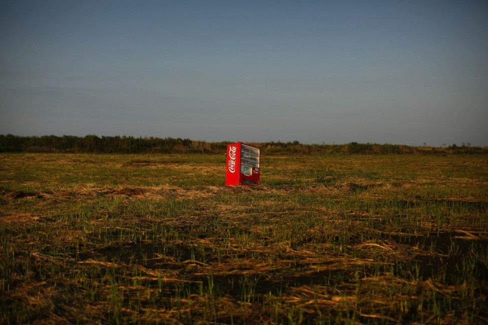 A vending machine, brought inland by a tsunami, is seen in a abandoned rice field inside the exclusion zone at the coastal area near Minamisoma in Fukushima prefecture