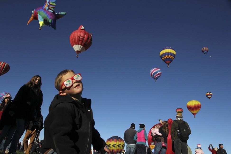 Visitors attend the 42nd annual Albuquerque International Balloon Fiesta in Albuquerque, New Mexico