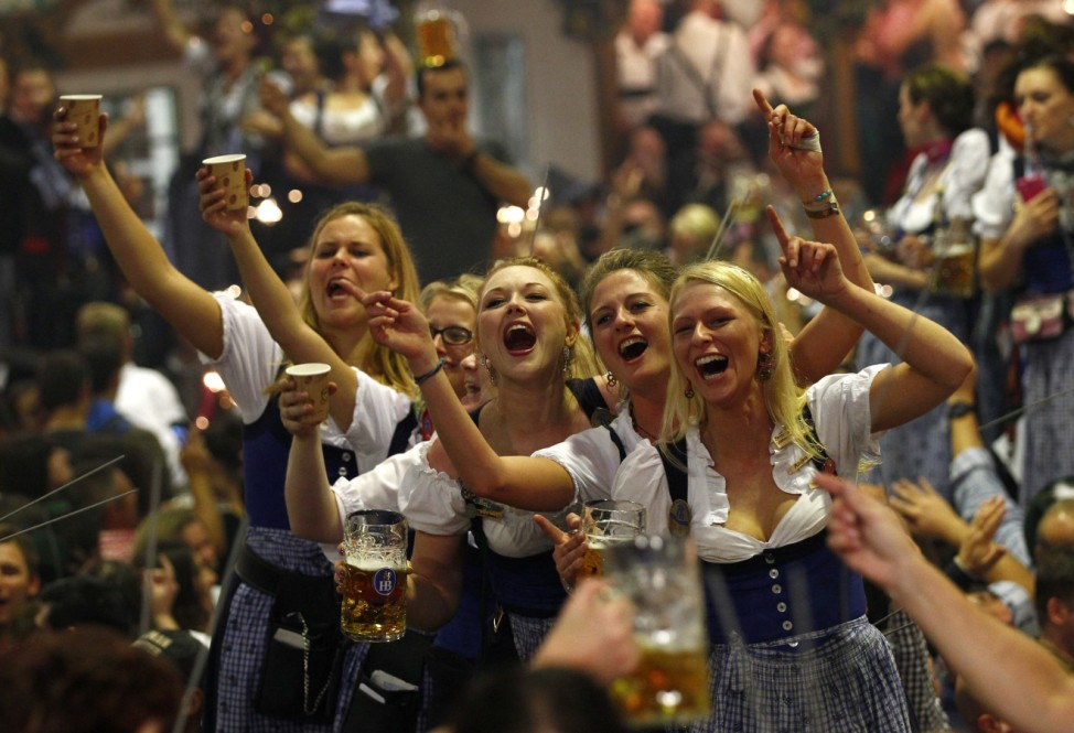Oktoberfest waitresses toast while they celebrate the end of the world's biggest beer festival, the 180th Oktoberfest, in Munich