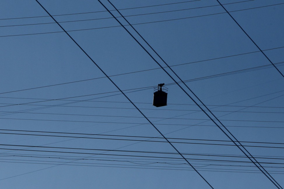 A cable car passes above the town of Chiatura