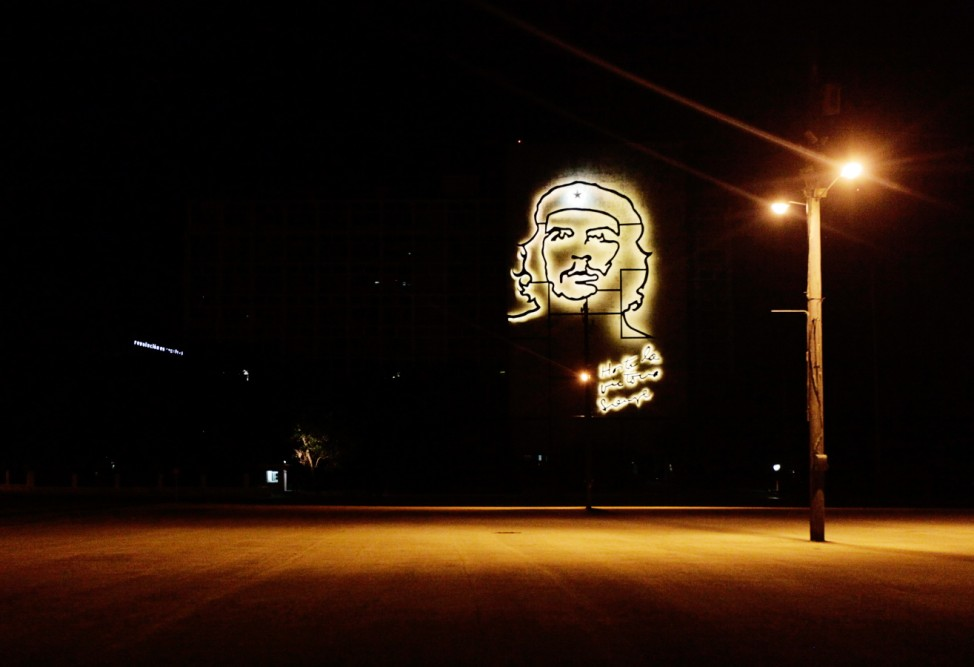 A bronze sculpture, by Cuban sculptor Avila, depicting revolutionary leader Guevara is illuminated on the facade of the Cuban Interior Ministry in Havana's Revolution Square