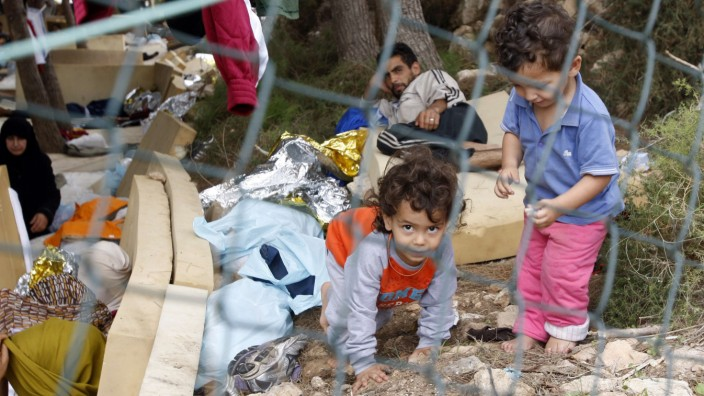 Migrant children play at the immigration centre on the southern Italian island of Lampedusa