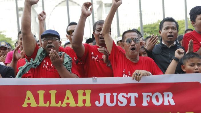 Muslim demonstrators chant slogans outside Malaysia's Court of Appeal in Putrajaya