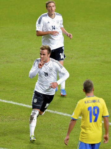 Germany's Goetze celebrates his goal against Sweden in front of teammate Kruse during their 2014 World Cup qualifying soccer match in Stockholm