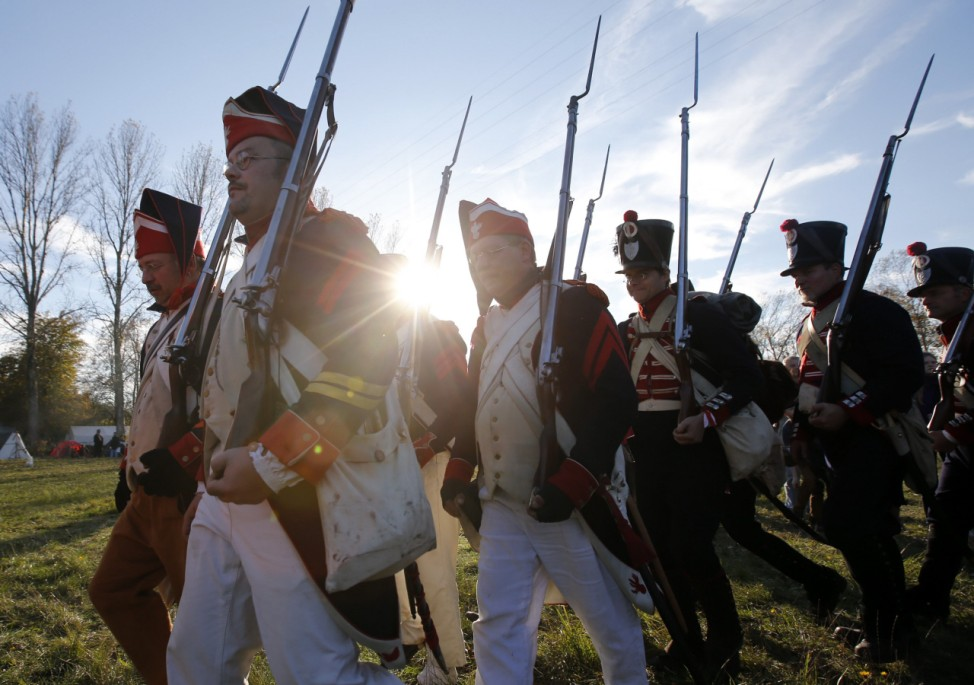 Performers wearing 19th century French military uniform practice for the reenactment of the Battle of the Nations in the village of Markkleeberg