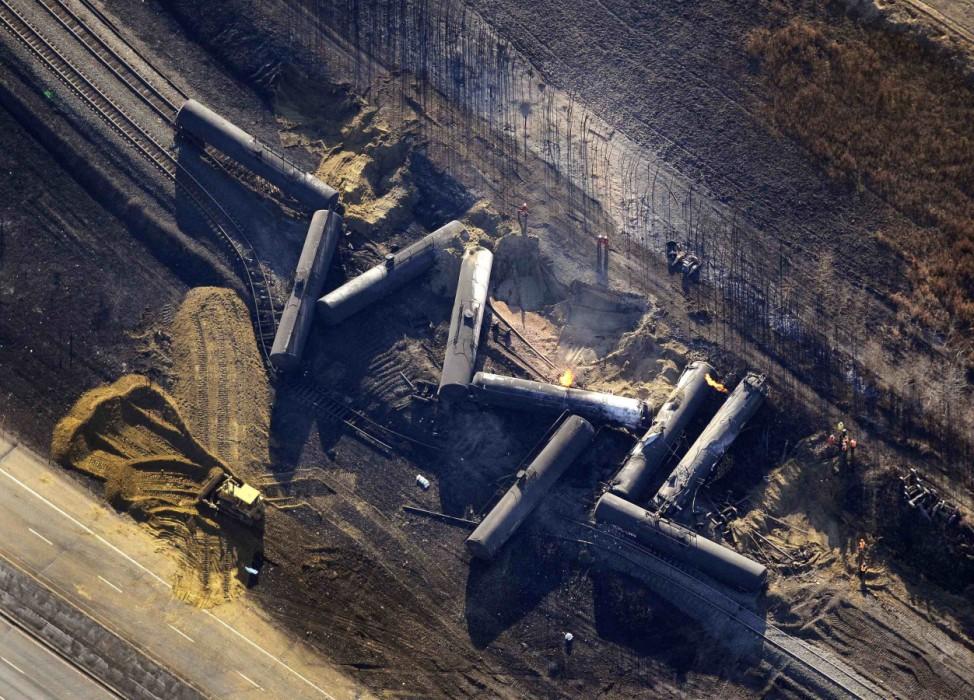 Investigators survey the site of a train derailment near the hamlet of Gainford