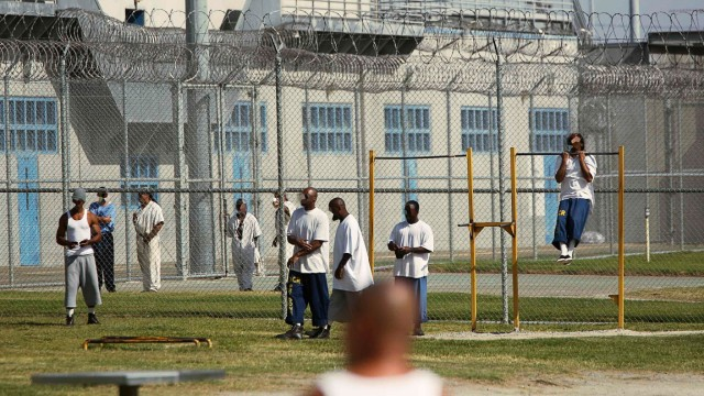 Inmates workout in the yard at Corcoran State Prison in California