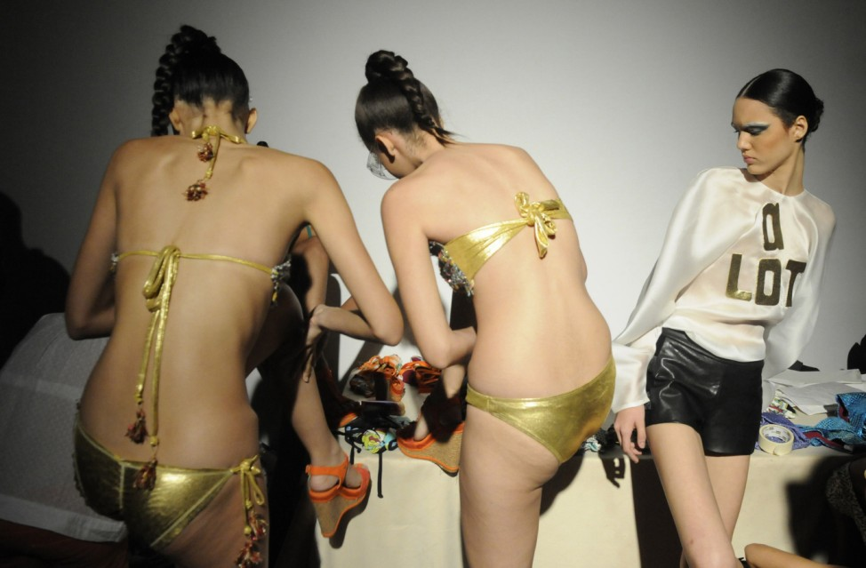 Models get ready backstage during the Dominicana Moda Fashion Week 2013 in Santo Domingo