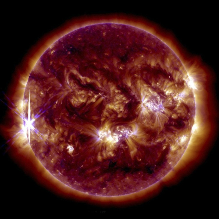 A solar flare is pictured erupting from the sun in this NASA handout photo from its Solar Dynamics Observatory
