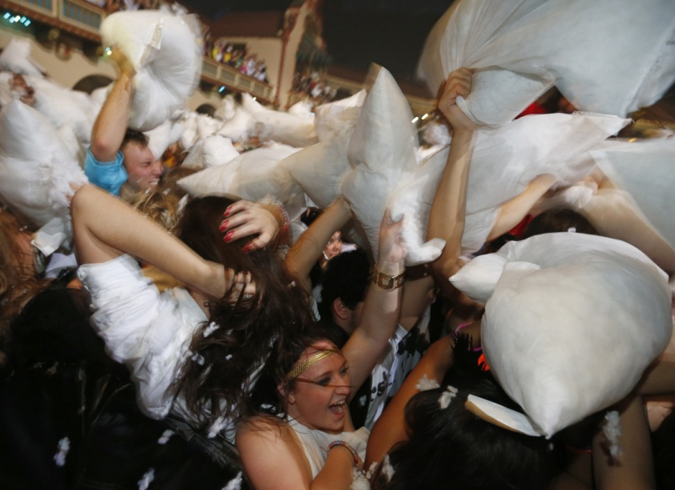 Participants take part in an attempt to set a new Guinness World Record for the largest pillow fight, in Chicago