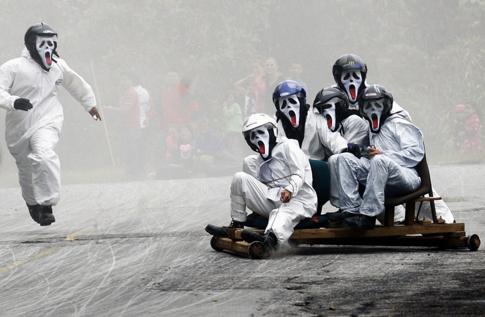 Participants descend a hill on a homemade roller cart during the 25th Roller Cart Festival in Medellin