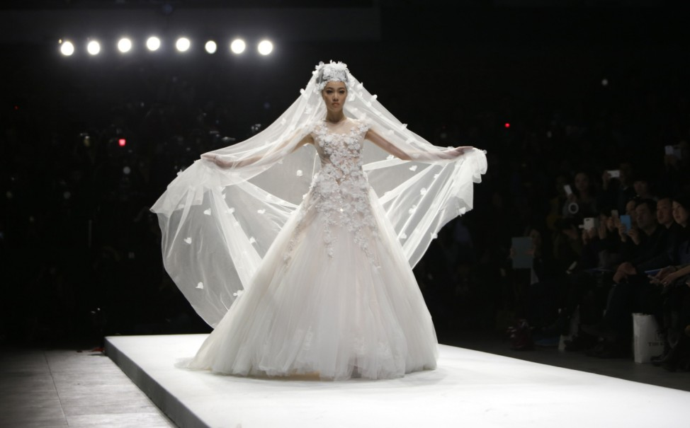 A model presents a creation by Chinese designer Zhang Jingjing at China Fashion Week in Beijing
