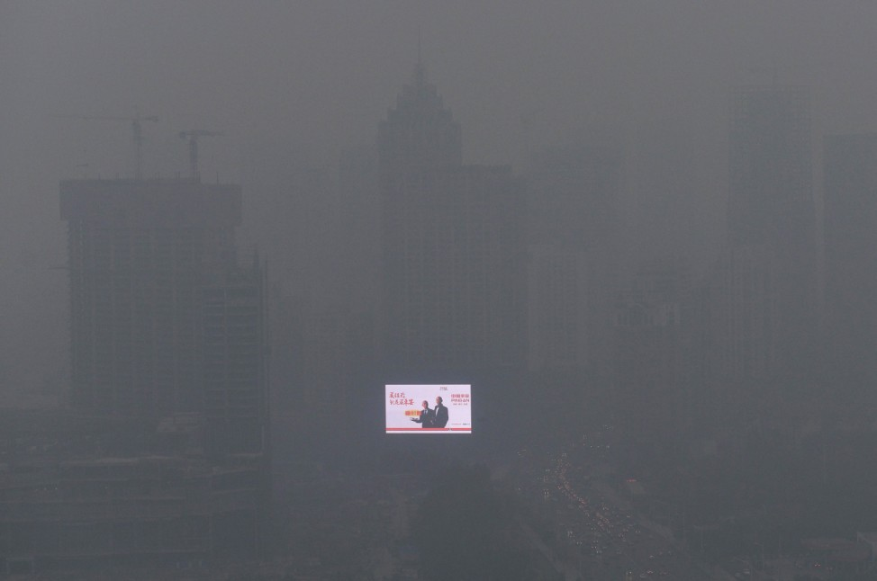 An electronic screen is seen on a building amid heavy smog in Shenyang