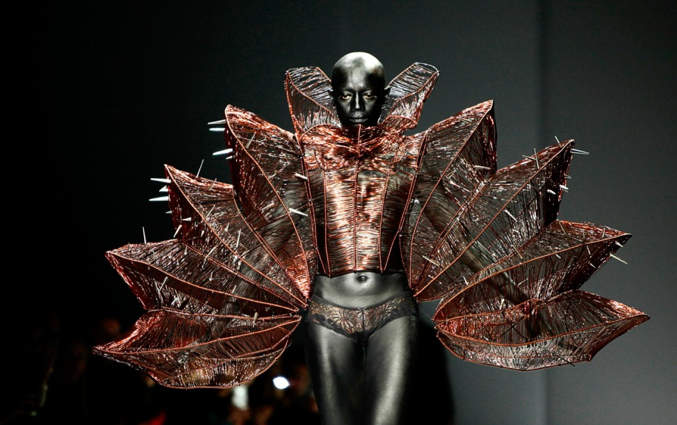 A model presents a creation by designer Hu Sheguang from Sheguang Hu Haute Couture Collection at China Fashion Week in Beijing