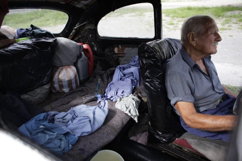 83-year-old Oscar Almaguer sits in his 1967 Volkswagen Beetle in Apodaca