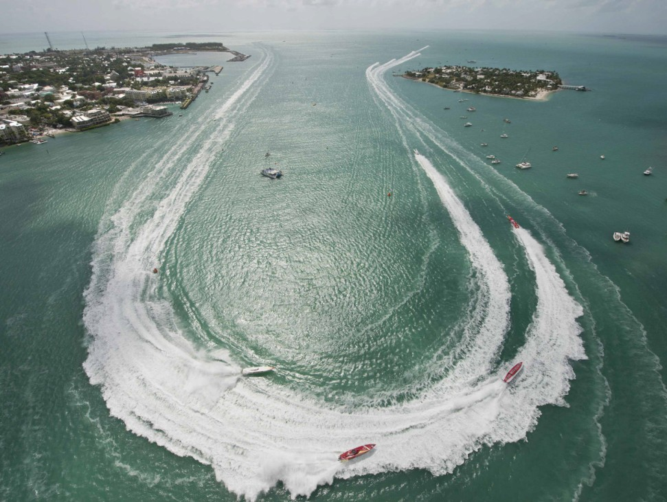 Super Boat Extreme class boats make a turn during the first of three race days at the Key West World Championships in Key West, Florida