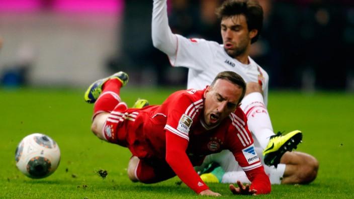 Augsburg's Moravek challenges Bayern Munich's Ribery  during their German first division Bundesliga soccer match in Munich