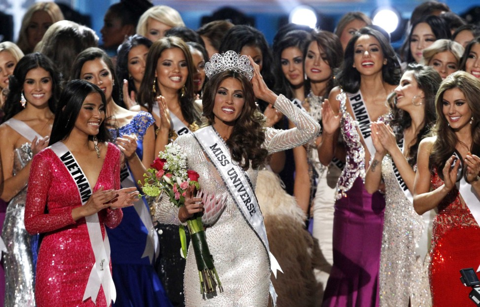Miss Venezuela Gabriela Isler reacts after winning the Miss Universe pageant in Moscow