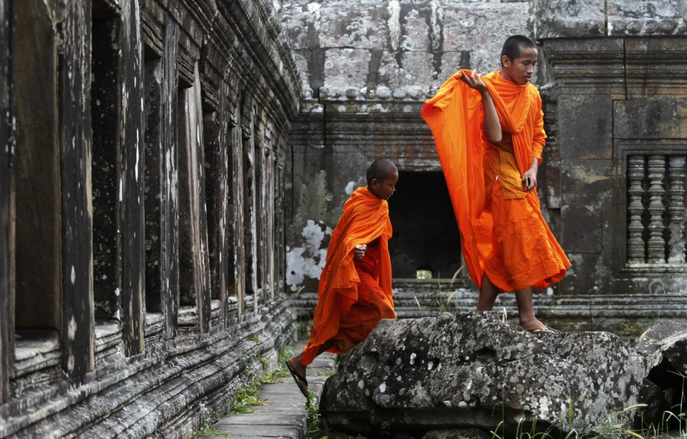 Buddhist monks visit the Preah Vihear temple on the border between Thailand and Cambodia