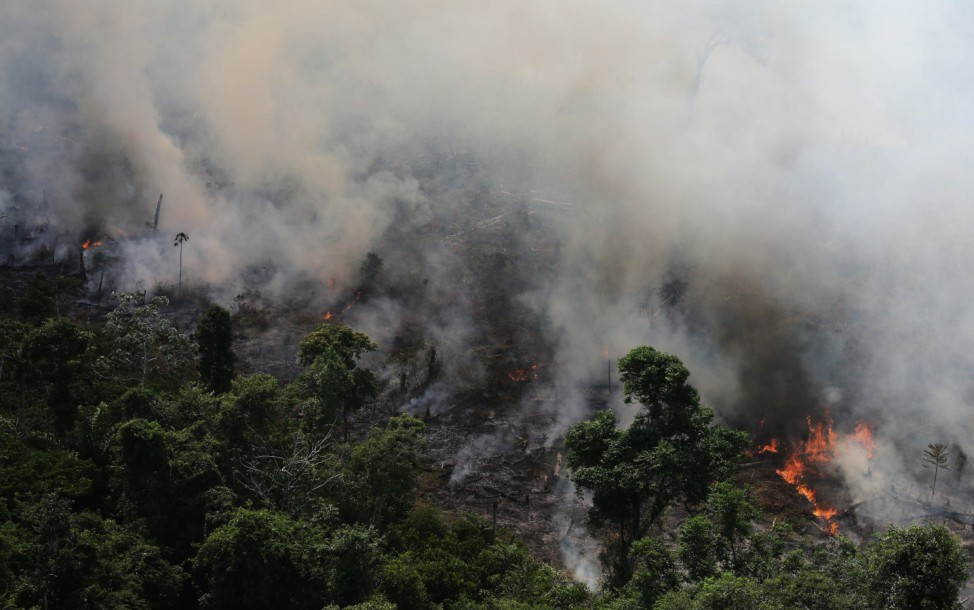 Smoke billows as an area of the Amazon rainforest is burnt to clear land for agriculture near Novo Progresso