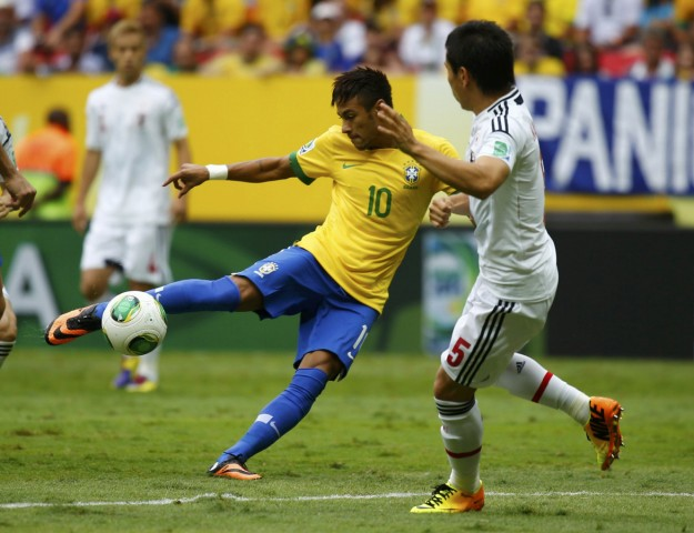 Brazil's Neymar kicks to score a goal during their Confederations Cup Group A soccer match against Japan at Estadio Nacional in Brasilia