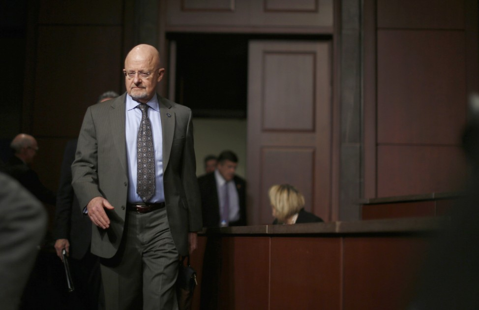 U.S. Director of National Intelligence Clapper arrives to testify at a House Intelligence Committee hearing in Washington