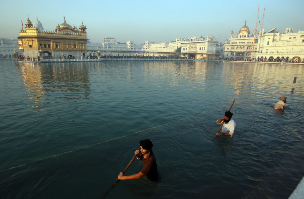 People pay obeisance at the Golden Temple, the holiest of Sikh sh