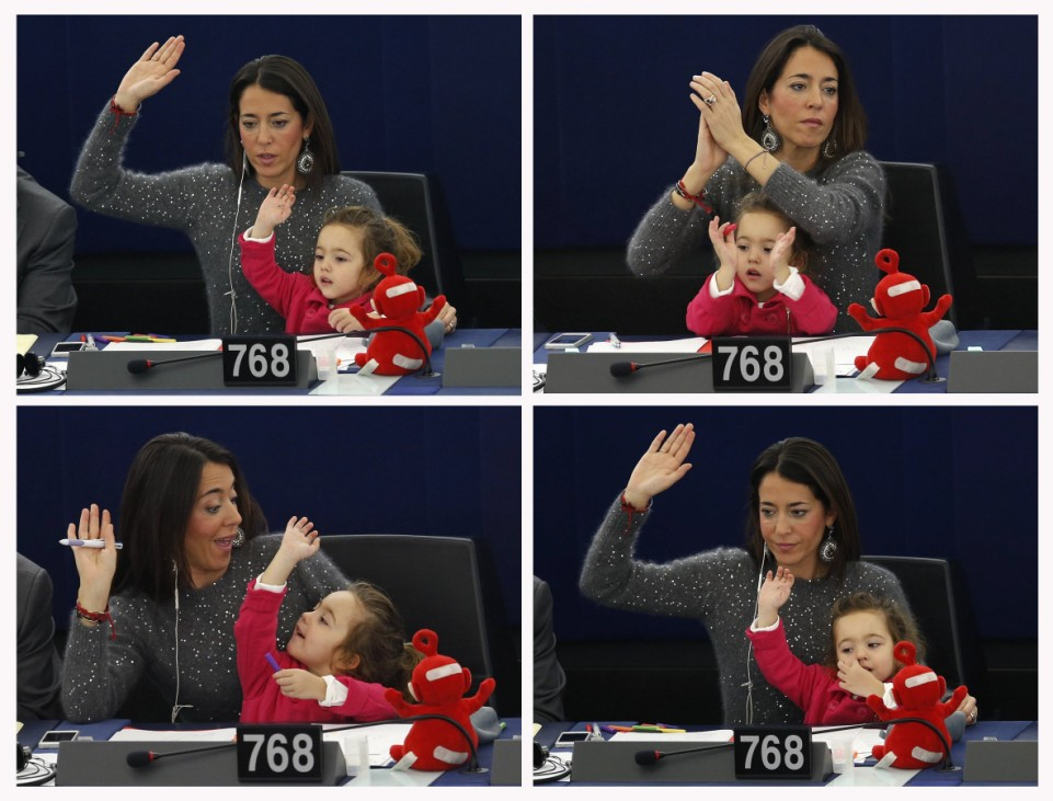 A combination picture shows member of the European Parliament Ronzulli of Italy taking part with her daughter Vittoria in a voting session at the European Parliament in Strasbourg