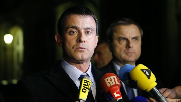 French Interior Minister Valls and Flaesch, director of the Paris judiciary police, attend a news conference in Paris