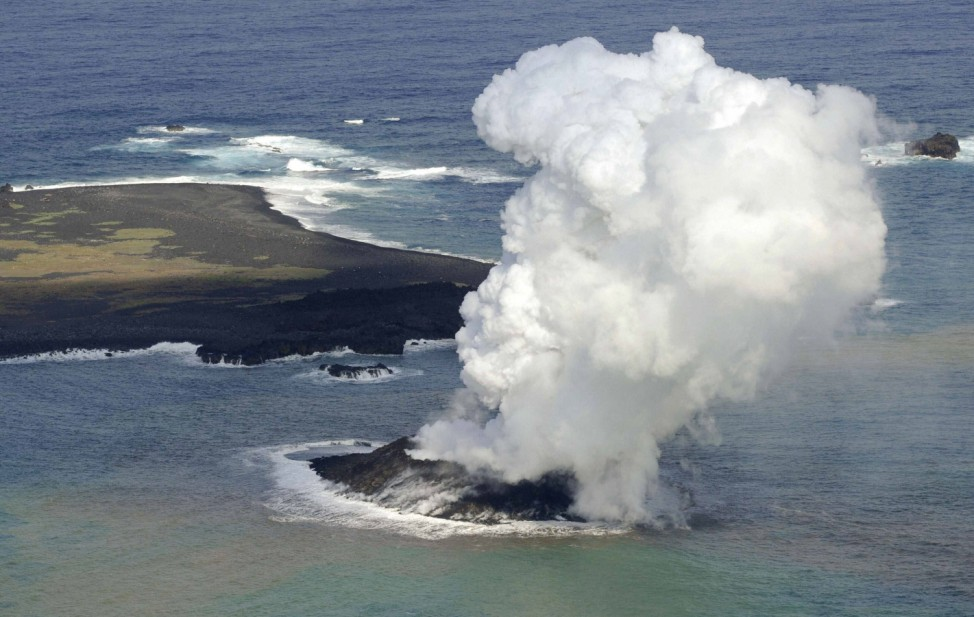 Smoke from an erupting undersea volcano forms a new island off the coast of Nishinoshima in the southern Ogasawara chain of islands