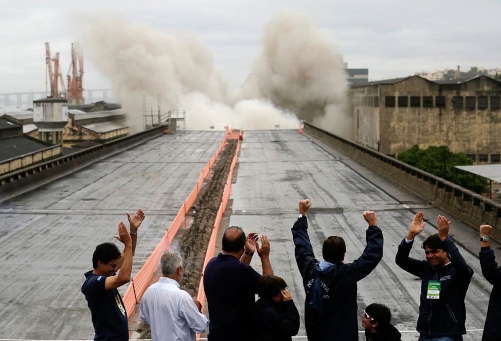 Local authorities celebrate at the moment of Perimetral overpass' demolition explosion in Rio de Janeiro