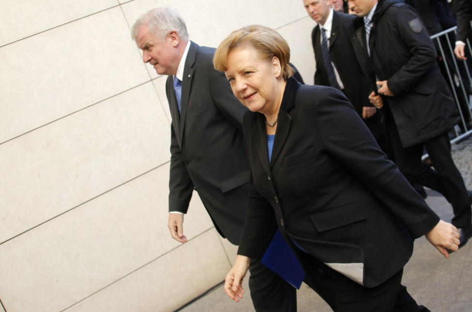 German Chancellor Merkel and head of CSU Horst Seehofer arrive for coalition talks with Social Democratic Party in Berlin