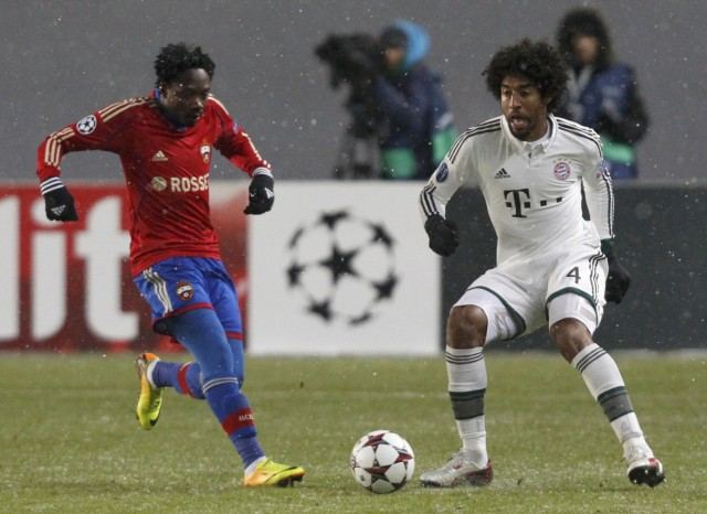 CSKA Moscow's Ahmed Musa fights for the ball with Bayern Munich's Dante during their Champions League soccer match at the Arena Khimki outside Moscow