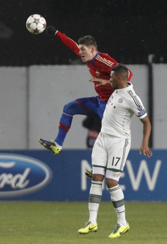 CSKA Moscow's Steven Zuber goes for a header with Bayern Munich's Jerome Boateng during their Champions League soccer match at the Arena Khimki outside Moscow