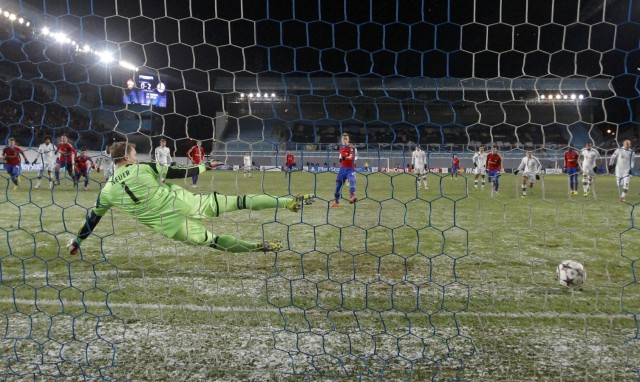 CSKA Moscow's Keisuke Honda scores a penalty kick past Bayern Munich's goalkeeper Manuel Neuer during their Champions League soccer match at the Arena Khimki outside Moscow