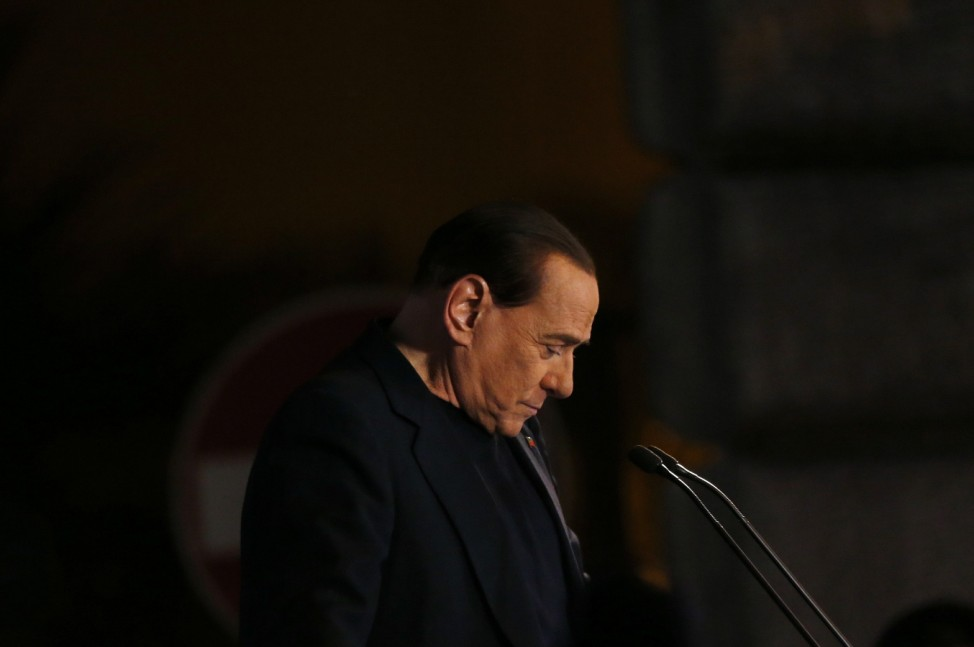 Former Prime Minister Silvio Berlusconi delivers a speech from the stage in downtown Rome