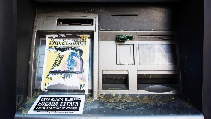 Sticker is seen on ATM machine of Bankia-Caja Madrid bank branch during demonstration against Spain's bailout in Madrid
