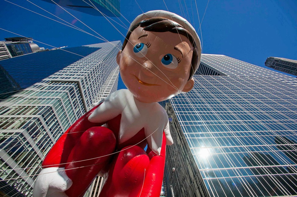 The Elf on the Shelf balloon floats down Sixth Avenue during the 87th Macy's Thanksgiving Day Parade in New York