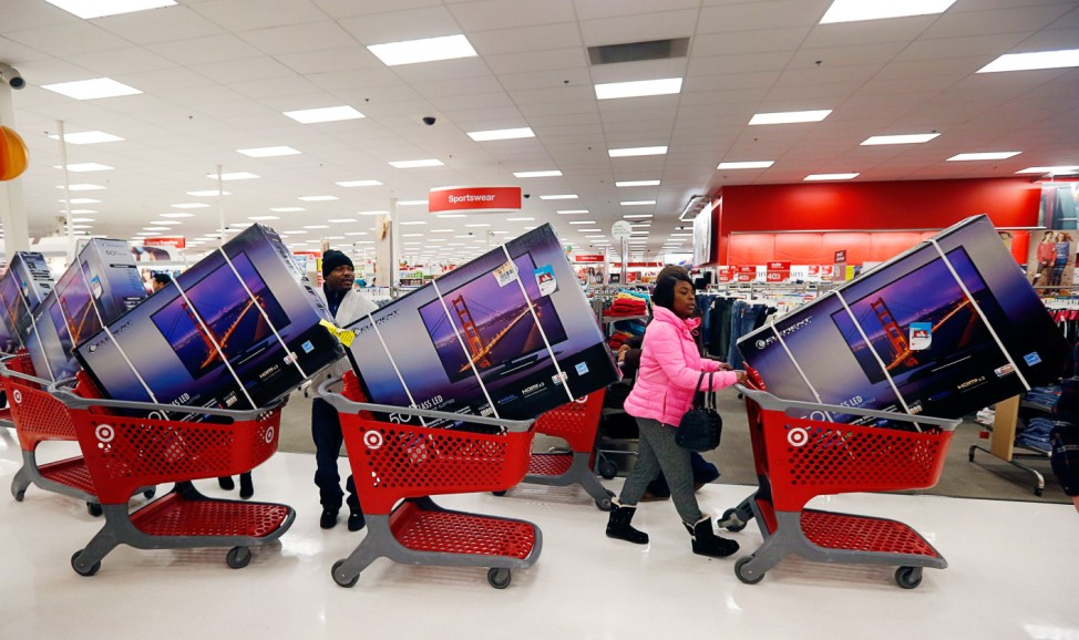 Thanksgiving Day holiday shoppers line up with television sets on discount at the Target retail store in Chicago