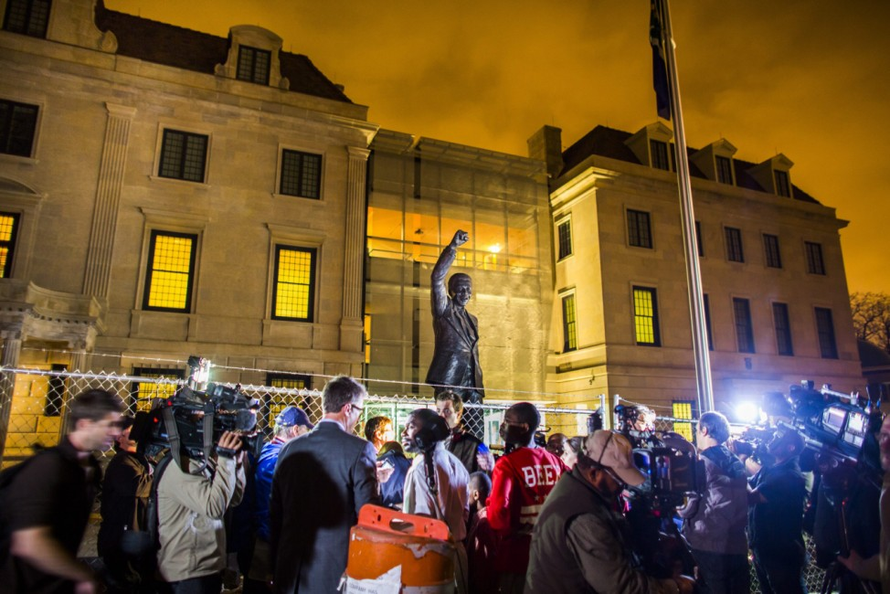 People Gather at statue of former South African President Nelson