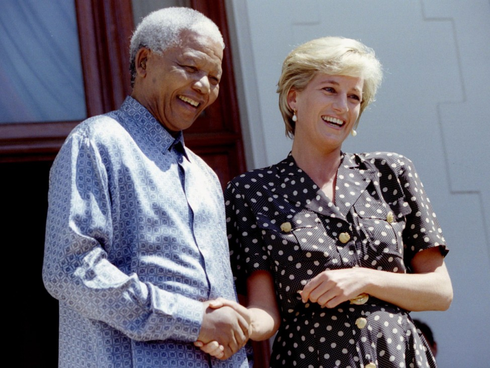 File photo of Diana, Britain's Princess of Wales, and South African President Nelson Mandela in Cape Town