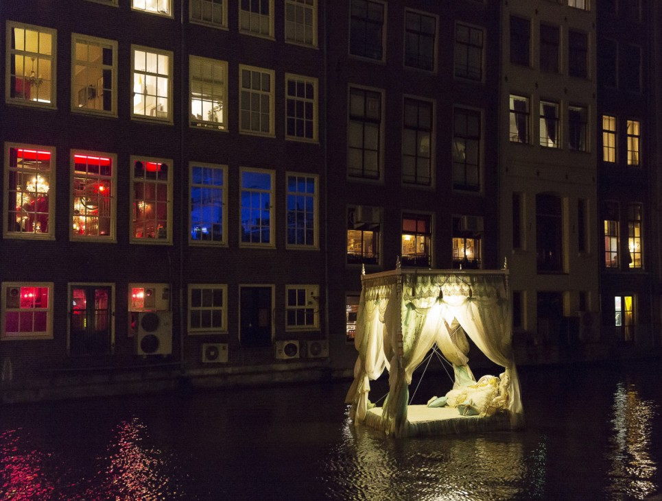 'Pas Encore Mon Histoire' by Vincent Olinet is pictured in the Red Light District as part of the Amsterdam Light Festival in Amsterdam